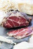 Carne curada caseiro Capocollo Carne de porco curada secada Coppa cortou em partes Carne de carne de porco envelhecida Charcuteri Foto de Stock Royalty Free