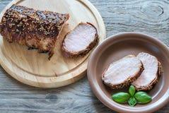 Carne de carne de porco cozida envolvida no bacon Fotos de Stock Royalty Free