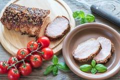 Carne de carne de porco cozida envolvida no bacon Fotografia de Stock
