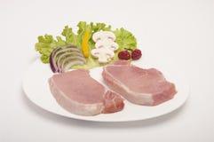 carne de cerdo sin procesar aislada en el fondo blanco imagen de archivo libre de regalías