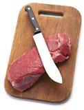 Carne de la carne de vaca con el cuchillo fotografía de archivo