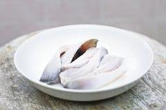 Carne de pescados en la placa imágenes de archivo libres de regalías