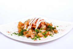 Carne de porco com batatas em uma placa Fotografia de Stock Royalty Free