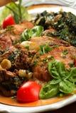Carne de porco com espinafre Fotografia de Stock Royalty Free