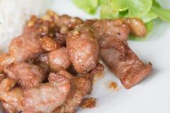 Carne de porco cortada fritada com alho Fotografia de Stock