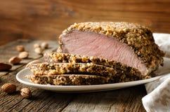 Carne de porco cozida na migalha da amêndoa fotos de stock royalty free