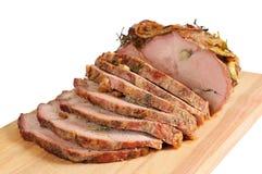 Carne de porco do assado em uma placa de madeira Fotografia de Stock