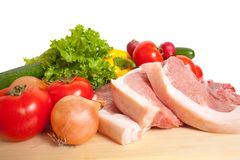 Carne de porco e vegetais crus fotografia de stock royalty free