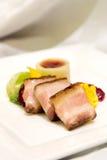 Carne de porco envolvida em Proscuitto Foto de Stock