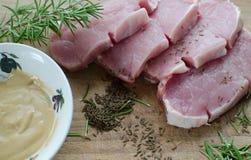 Carne de porco fresca com mostarda Imagens de Stock