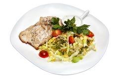 Carne de porco fritada com vegetais e salada Imagem de Stock