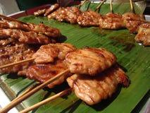 Carne de porco Roasted nas varas de bambu Fotografia de Stock