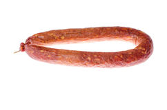 Carne de salsicha do alimento em um fundo branco Imagem de Stock Royalty Free