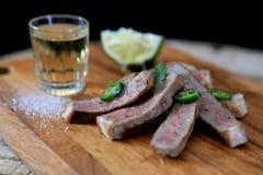 Carne de vaca adobada Tequila Foto de archivo libre de regalías