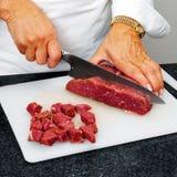 Carne de vaca del corte del cocinero fotografía de archivo