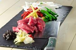 Carne de vaca en ingredientes de la fritada del stir de la haba negra Foto de archivo