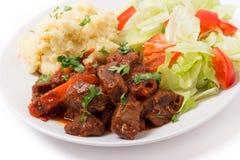 Carne de vaca griega en salsa roja Imagen de archivo libre de regalías