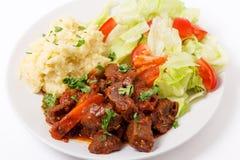 Carne de vaca griega en salsa roja Imágenes de archivo libres de regalías