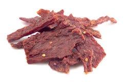 Carne de vaca seca quente e picante da pilha com os flocos de pimenta vermelha imagem de stock