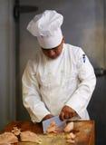 Carne del corte del cocinero Imagen de archivo libre de regalías