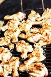 Carne del pollo sulla griglia Fotografie Stock