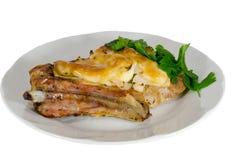 Carne di maiale al forno con le spezie su un piatto Fotografia Stock