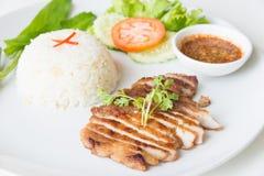 Carne di maiale arrostita con il riso fritto dell'aglio Immagini Stock