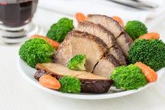 Carne di maiale calda casalinga con le verdure Fotografia Stock