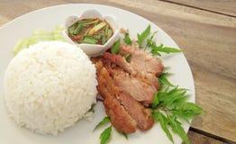 Carne di maiale del collo del BBQ con riso Immagini Stock