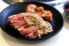 Carne di maiale e verdura in ristorante giapponese Fotografia Stock