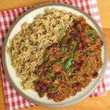 Carne di manzo con salsa al peperoncino rosso con riso sbramato Immagini Stock Libere da Diritti