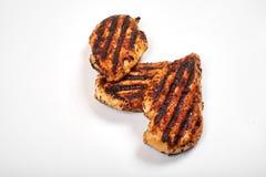 Carne di pollo Pezzi arrostiti del raccordo isolati su fondo bianco Fotografie Stock Libere da Diritti