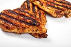 Carne di pollo Pezzi arrostiti del raccordo isolati su fondo bianco Immagine Stock