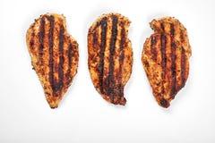 Carne di pollo Pezzi arrostiti del raccordo isolati su fondo bianco Fotografia Stock