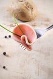 Carne di taglio su una forcella Fotografie Stock Libere da Diritti