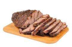Carne do assado em uma placa de madeira Fotos de Stock Royalty Free