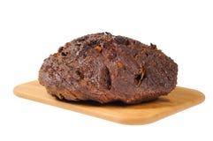 Carne do assado em uma placa de madeira Imagens de Stock Royalty Free