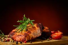 Carne e alecrins grelhados Fotos de Stock Royalty Free