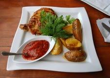 Carne e patate cotte Immagini Stock