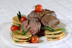 Carne e tomate Imagem de Stock