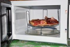 Carne en microonda Imagen de archivo libre de regalías