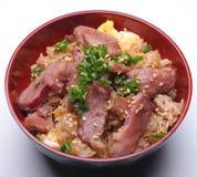 Carne en un arroz Fotografía de archivo libre de regalías