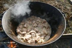 Carne en una caldera 4 Fotos de archivo
