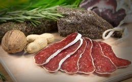 Carne francesa cortada na madeira Imagem de Stock Royalty Free
