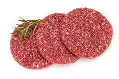 Carne fresca crua do Hamburger no branco Fotografia de Stock Royalty Free
