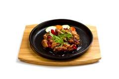 Carne fritada com vegetais Fotos de Stock Royalty Free