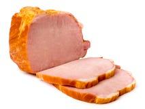 A carne fumado cortou em partes em um branco, isolado foto de stock