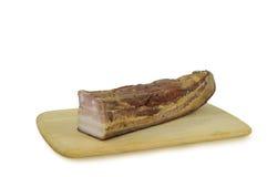 Carne fumado na placa de madeira isolada no fundo branco Imagem de Stock Royalty Free