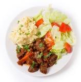 Carne grega no molho vermelho Fotografia de Stock Royalty Free