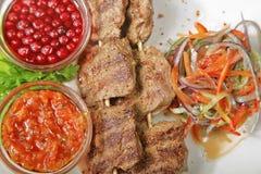 Carne grelhada com airela Imagem de Stock Royalty Free
